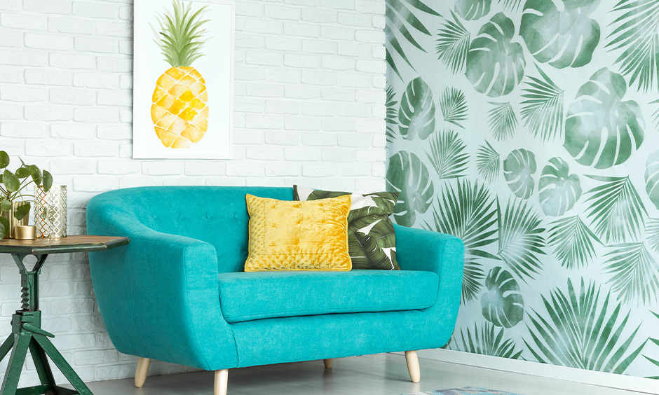 The living room has a sofa in turquoise and a pillow in a yellow analogous color scheme that brings aesthetic.