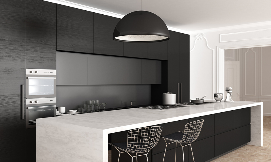 The island kitchen with black and grey kitchen cabinets combination is iconic and bold with a white countertop.