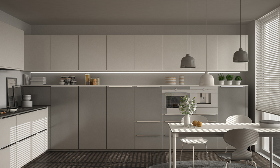 Kitchen cum dining area design with minimalist grey kitchen cabinet colours and modern look dining table.