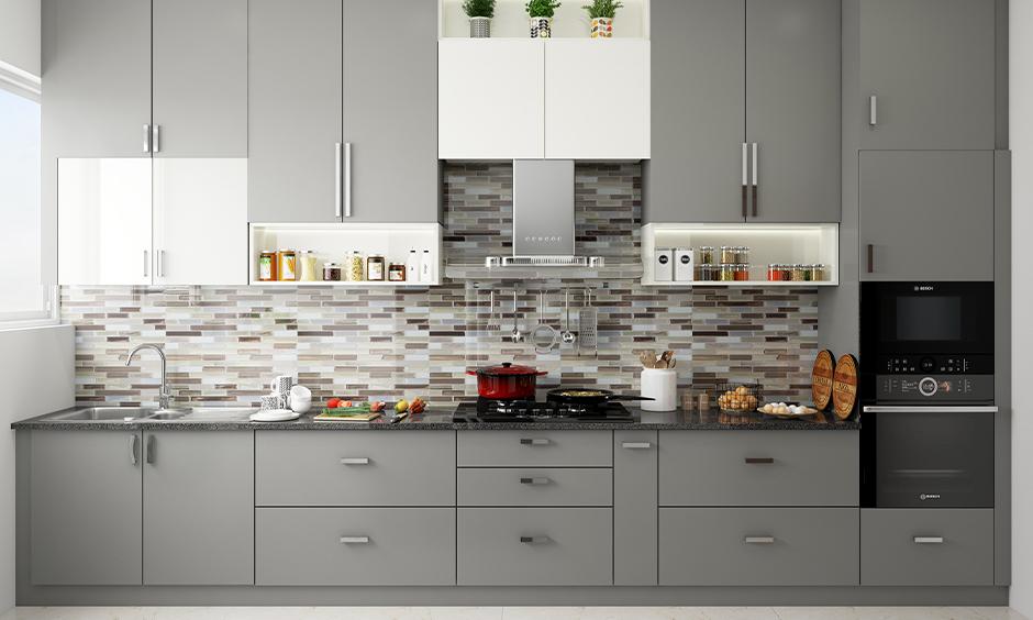 One-wall kitchen designed with modern grey kitchen cabinets and coloured brick backsplash looks sleek.