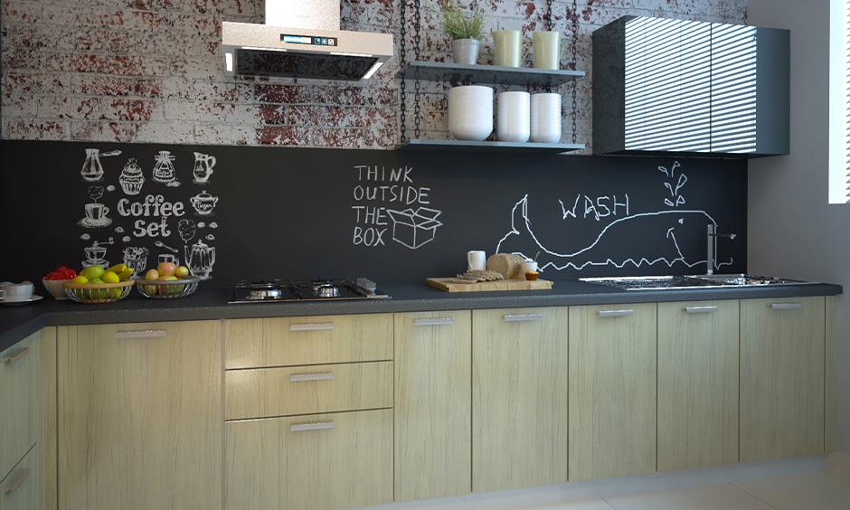 Modern kitchen wall tiles ideas, the kitchen has chalkboard backsplash with art on it looks attractive.
