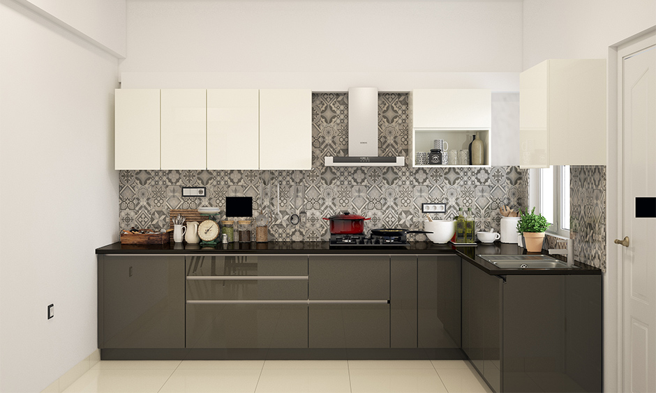 Modern grey kitchen wall tiles with a flowery pattern backsplash in an l-shaped kitchen lend aesthetic.