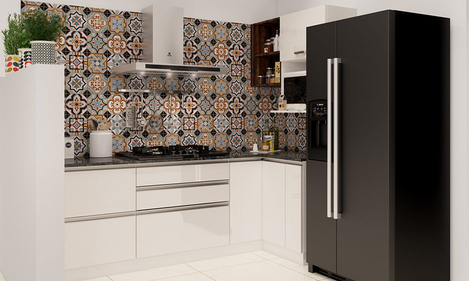 Modern kitchen wall tiles in pattern design with contrasting shades of black, yellow and blue looks charming.