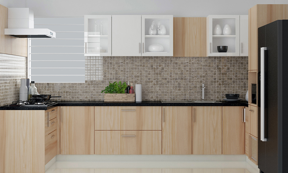 U-shaped kitchen with mosaic backsplash tiles in multi-shades of brown is the modern kitchen wall tiles texture.