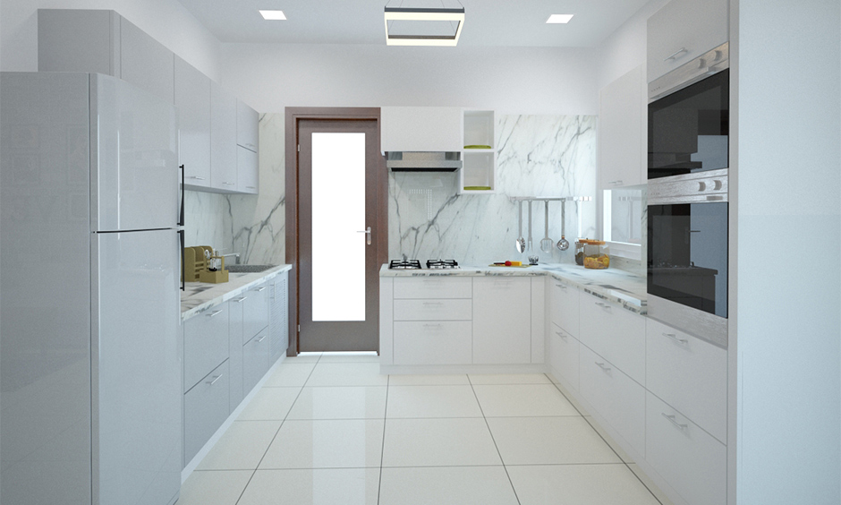 Marble modern kitchen wall tiles in the charming all-white u-shaped kitchen with shiny cabinets.