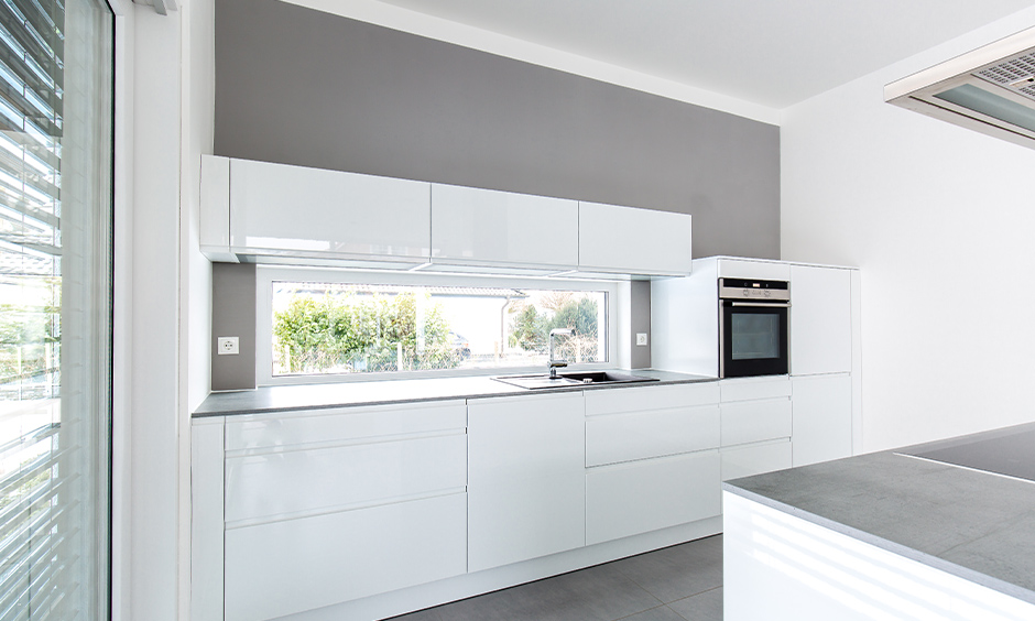 All-white kitchen with modern high gloss white kitchen cabinets look classy.