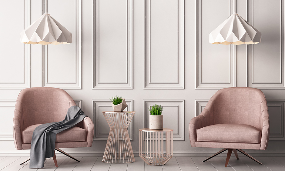 Pink living room with a pastel pink wallpaper and a piece of darker pink furniture