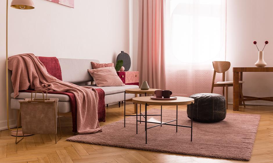 Floor to ceiling pink setup in pink living room