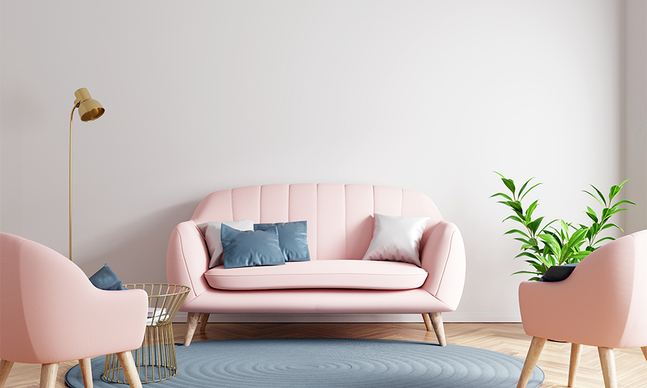 Pink living room furniture design with pink chesterfield style sofa