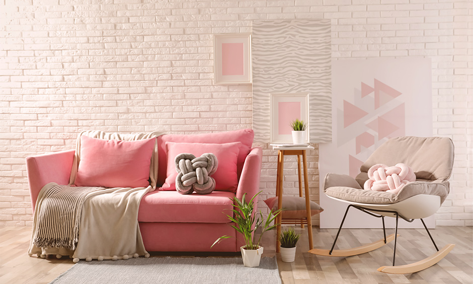 Pink walls living room design with brick pink wall