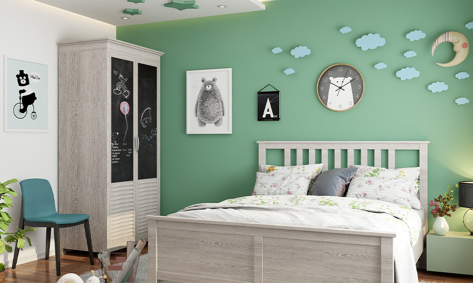 Kid's bedroom vintage wardrobe decorated with paint and attached blackboard look chic old almirah decoration.