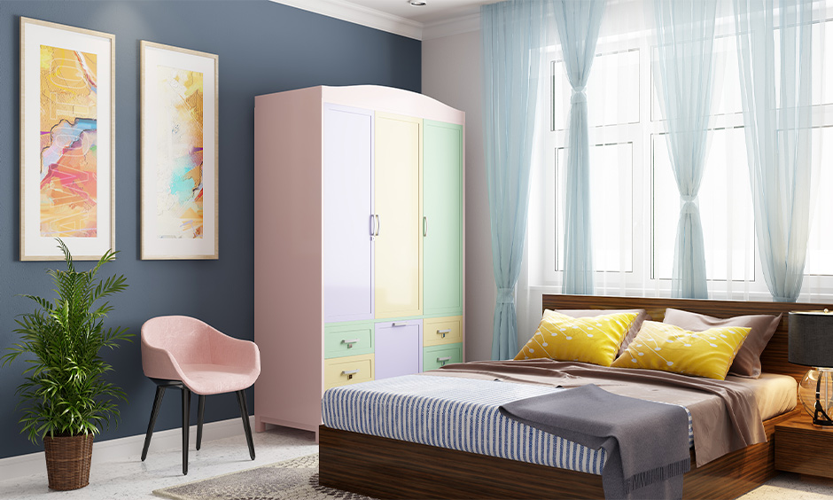 How to decorate almirah, Classic bedroom with a modern twist has a wardrobe decorated in pastel laminates.