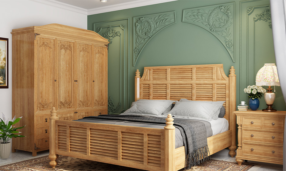 Vintage wooden wardrobe decorated the borders in patterns of flowers and symbols is decorative wooden almirah.