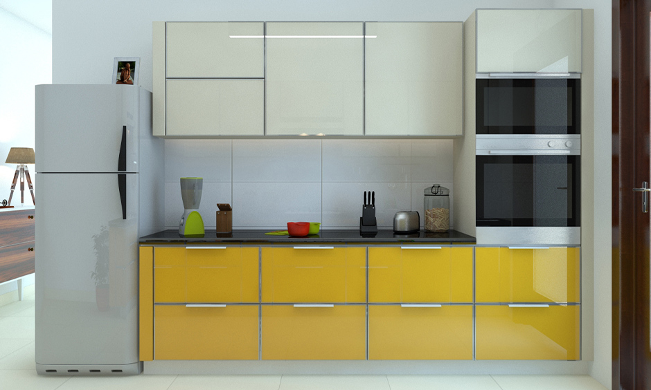 White and yellow modular kitchen with high gloss finish cabinets look luxurious and soothing.