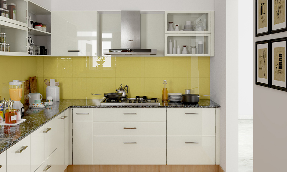 L-shaped yellow and white kitchen, White cabinets and backsplash in yellow colour in minimal design look delightful.
