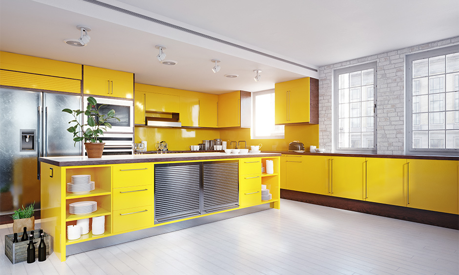 Yellow kitchen island combined with grey and white colour look aesthetic.