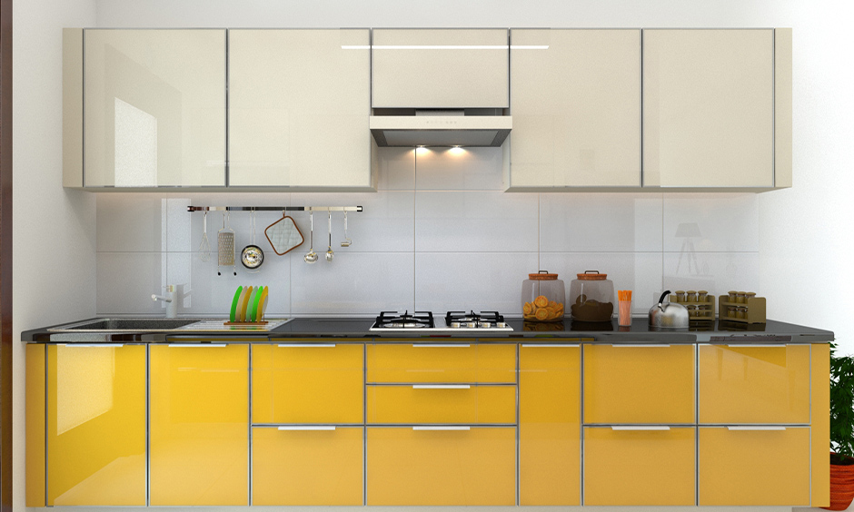 One-wall kitchen has gloss finish kitchen cabinets in white and yellow colour look plusher.