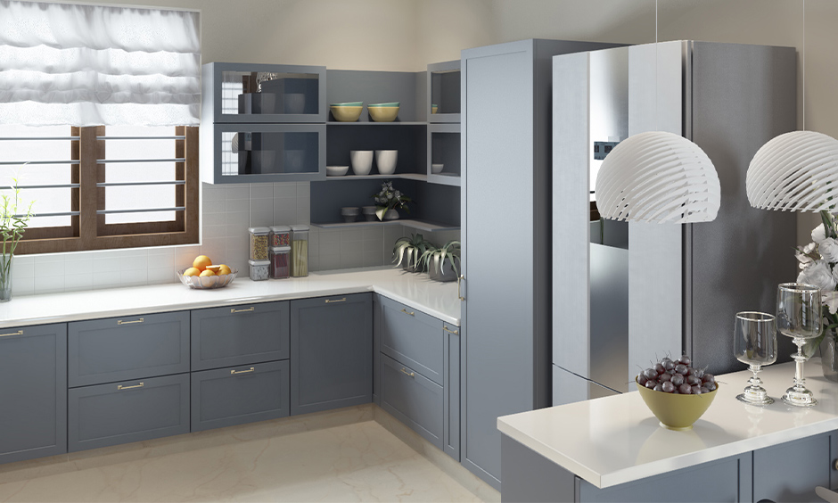 Small kitchen designed with matt finish cabinets in grey colour looks modern is the best finish for kitchen cabinets.