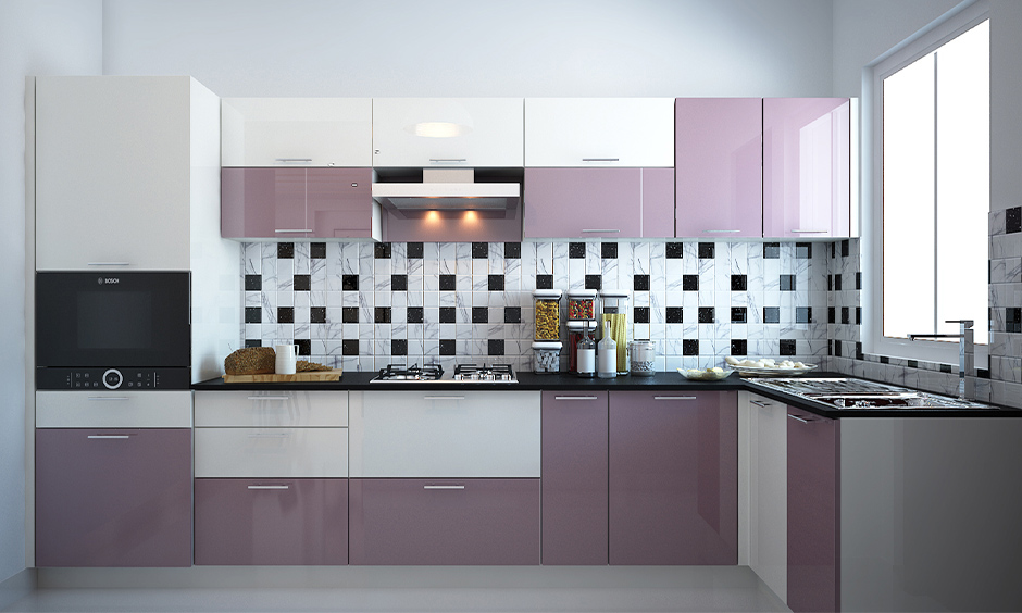 Glossy finish kitchen cabinets in white and light purple colour in the l-shaped kitchen look gorgeous.