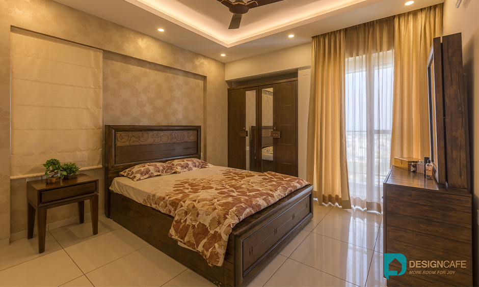 Bedroom interiors in Whitefield with wooden theme and dressing table made from wood creates a rustic feel.
