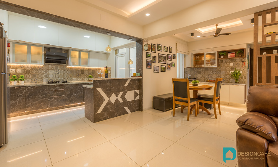 Dining area between living and kitchen with a round dining table and chairs look chic, good interior designers in Whitefield, Bangalore.
