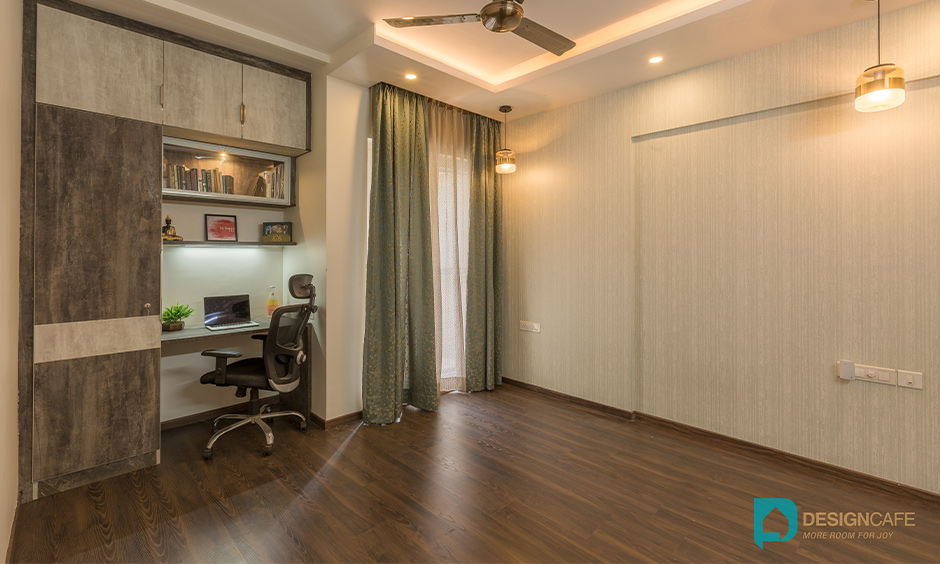 Master bedroom cum study area designed with an elegant wallpaper gives a rustic feel, best interior designers in Whitefield.