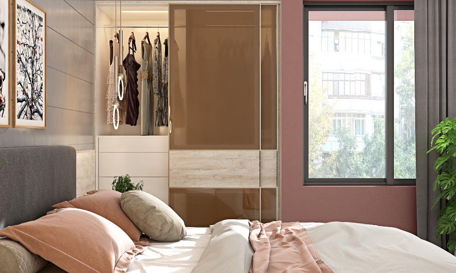 Bedroom designed with grey pink and white colour scheme in 1bhk home design