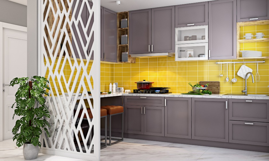 Modular kitchen designed in grey with metal handles in 1bhk house design