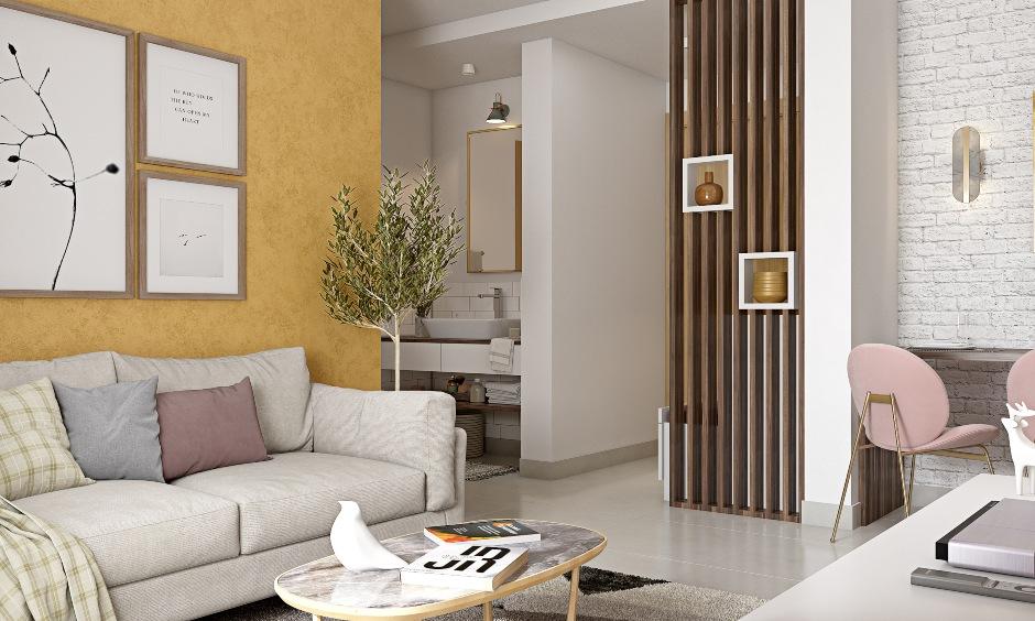 Elegant living room design with cosy sofa in 1bhk apartment design