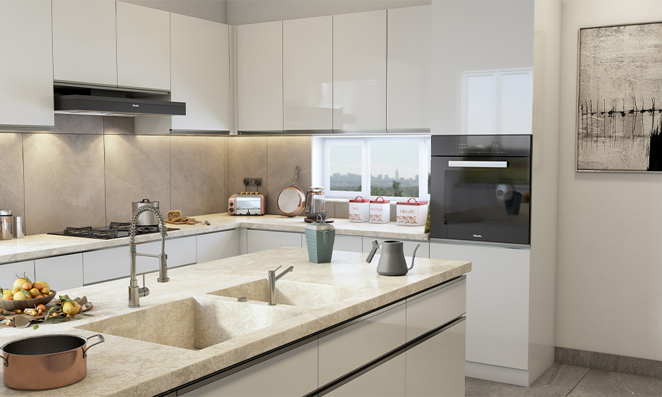 The integrated double-bowl kitchen sink with marble top in the white island kitchen is multi-functional.
