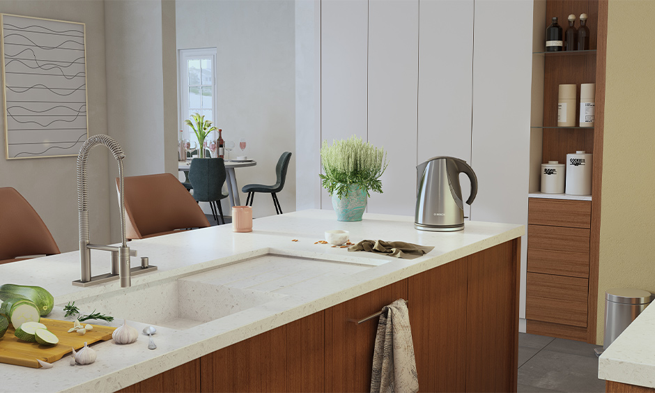 Integrated marble kitchen sink with drainboard and cabinets below in wooden finish in the island kitchen look chic.