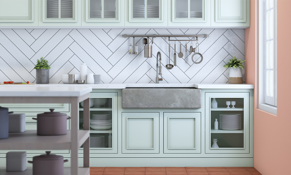 Large rectangular grey marble kitchen sink color and cabinet below in mint green look sleek and classic.