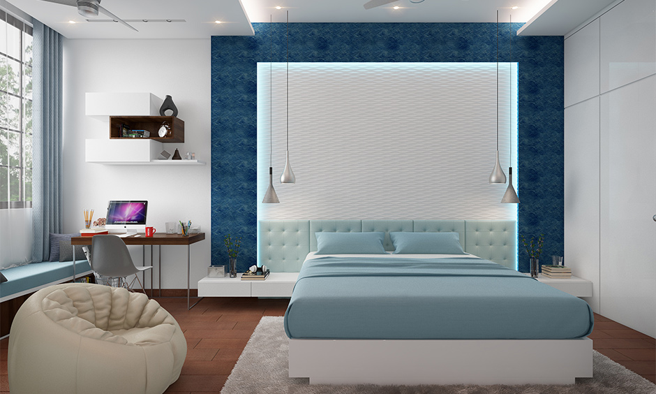 Blue and white bedroom cum study room designed with false ceiling and hanging lights stylish look.