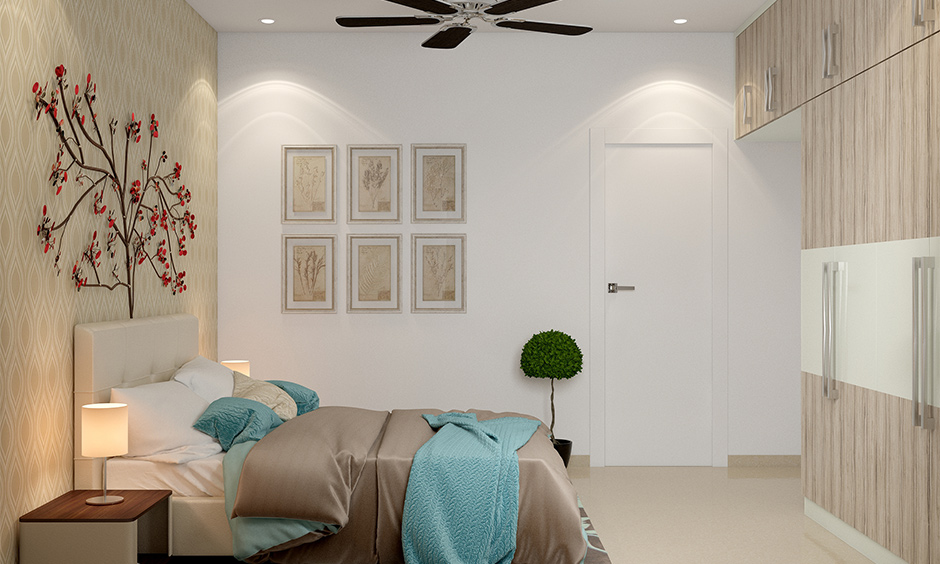White bedroom with colourful cushion, comforter, and decor accents looks elegant white bedroom interior.