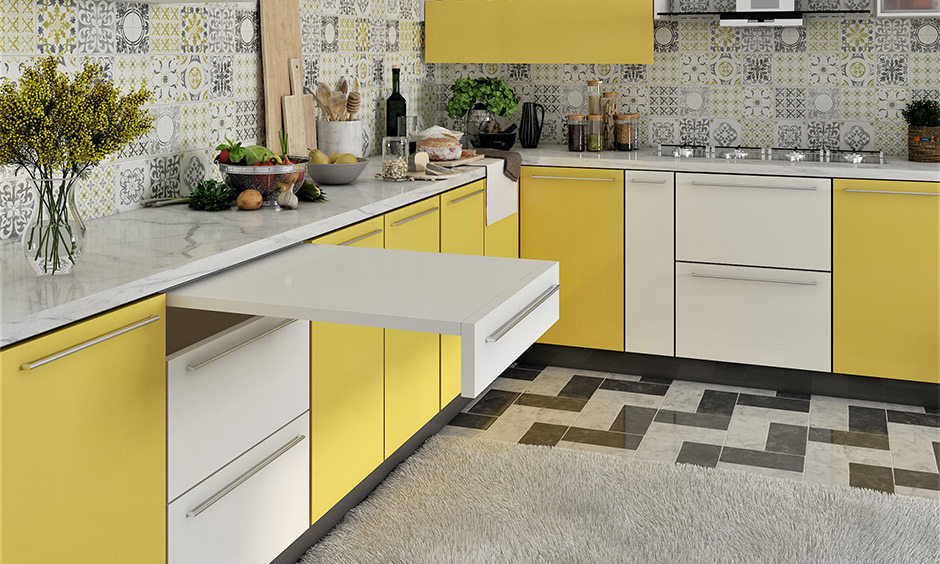 Light yellow two tone kitchen cabinets make a natural and pleasant pair in this kitchen