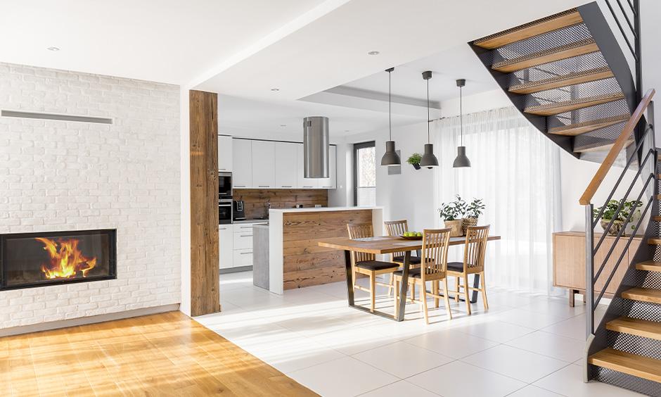 White floor tiles design, kitchen cum dining area has white limestone floor tiles sleek and stunning look.