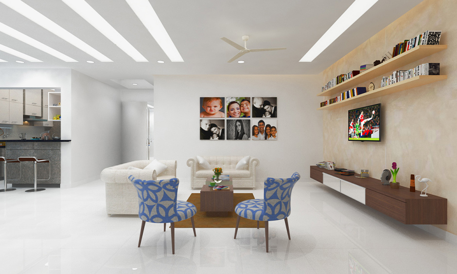 Porcelain modern white floor tiles in the living cum dining area look refreshing with two white sofas.
