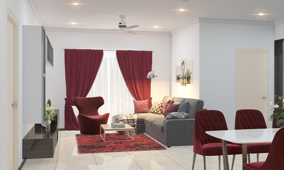 Living cum dining area in cherry red and grey combination looks bright is how to choose colour combination for home.