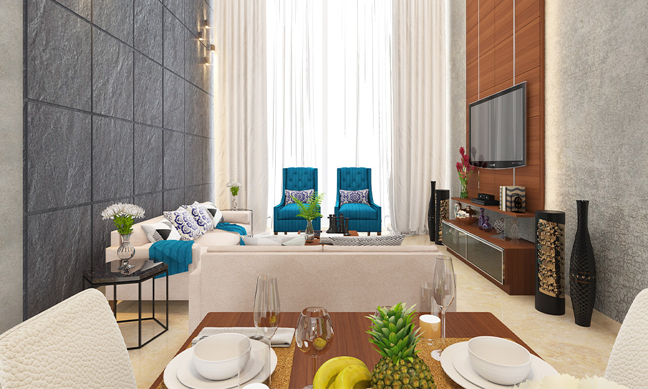 The teal and grey combination brings a vivid look to the living cum dining area, two colour combinations for home.