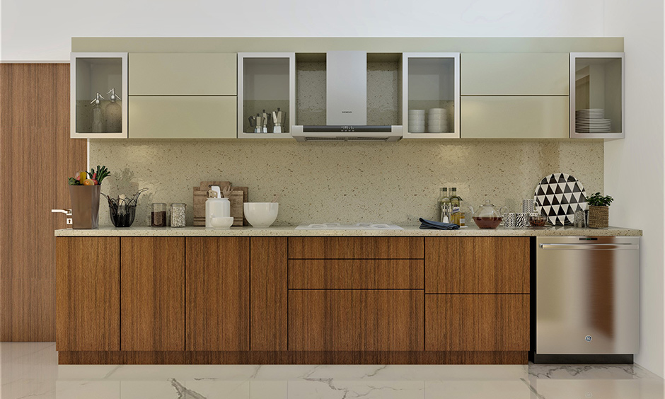 Stainless steel kitchen cabinets online with glass doors which softens the extra shine of stainless steel
