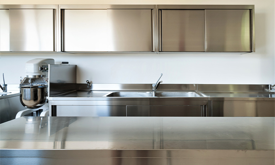 Stainless steel kick plates for kitchen cabinets with sliding doors which give an elegant and neat look to the kitchen interiors