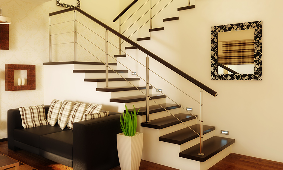 The black marble design on stairs in the living room looks bold and modern.