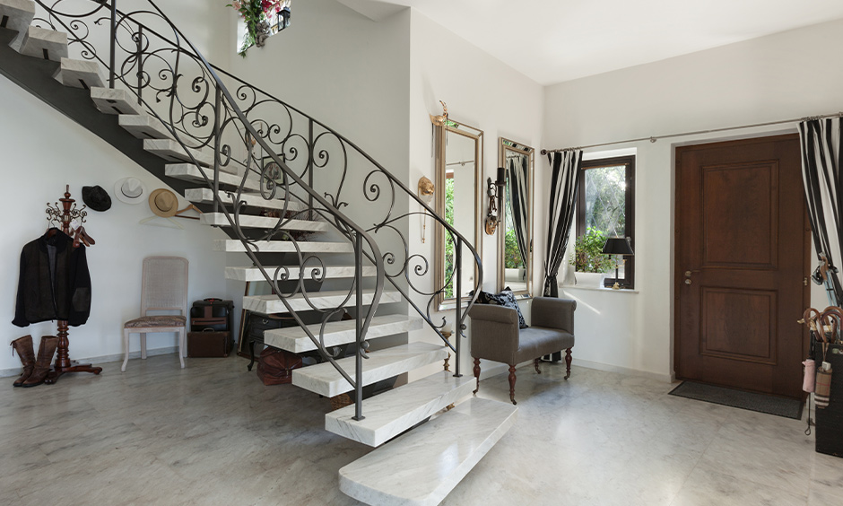 Italian marble stairs design with metal railing in the luxury duplex house looks aesthetic.