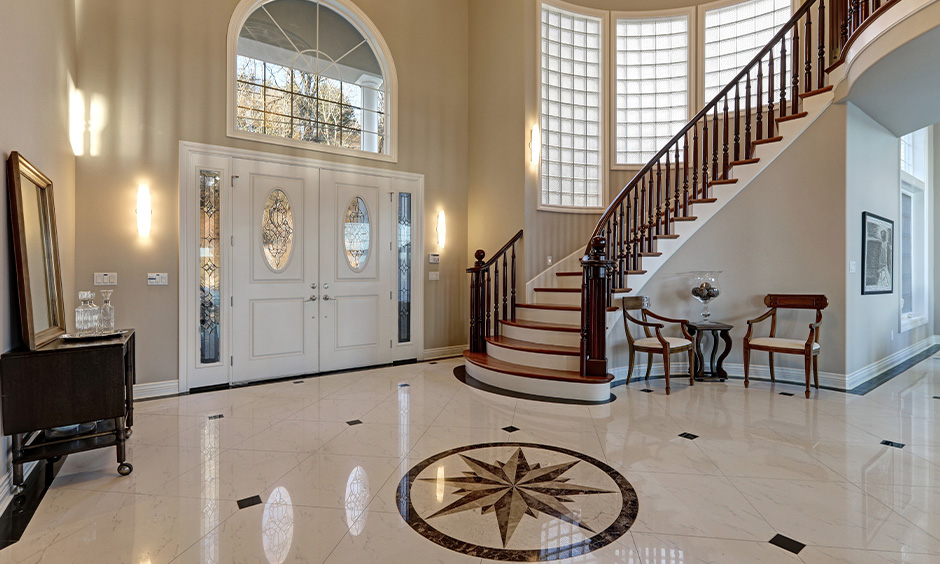 Elegant stair marble design with wooden railing in the hallway adds a vintage look to your modern home.