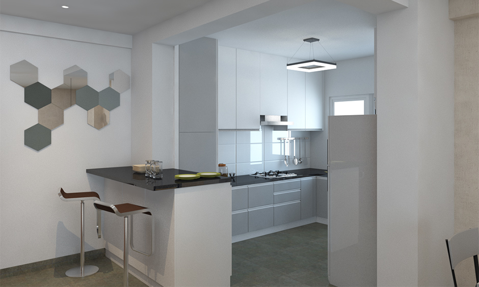 All-white small open kitchen design Indian style with breakfast counter looks modern.