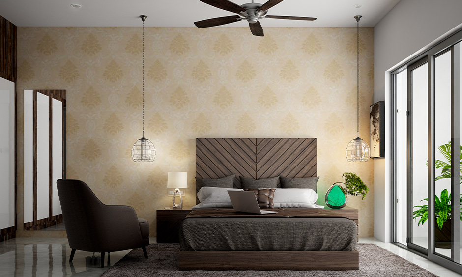 A large wooden bedhead with diagonal stripes design in a coffee-brown shade in the modern bedroom looks classy.