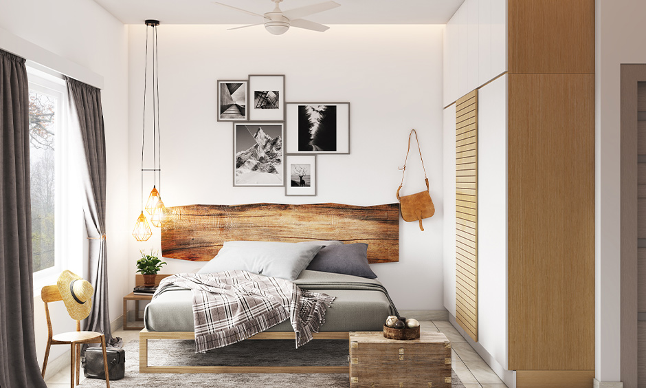 Bed with a unique wooden headboard design in the white bedroom brings a farmhouse vibe.