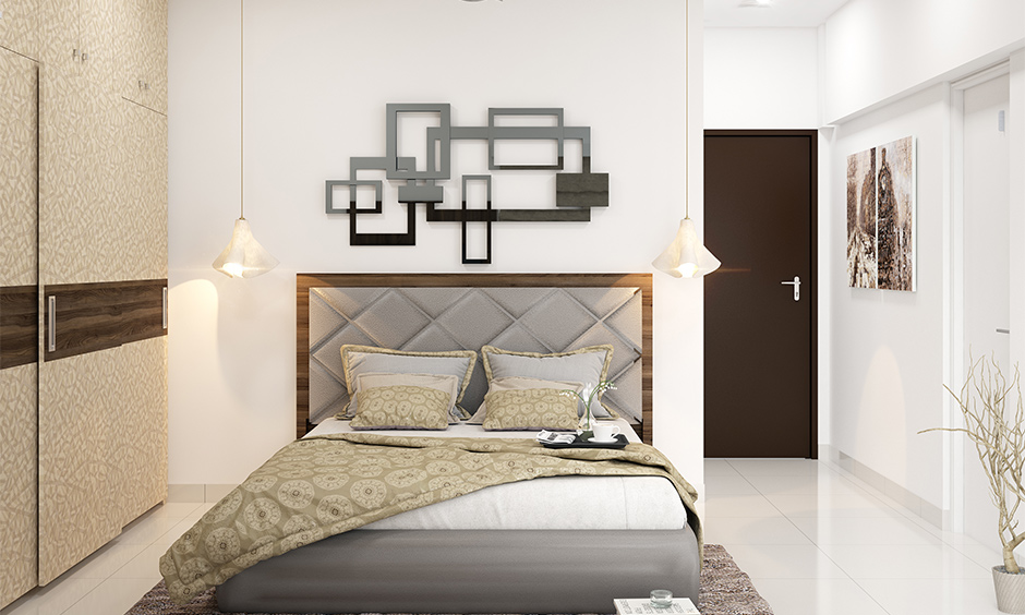 Wooden bed head frame with the tufted upholstered middle in grey colour lends a glam look.