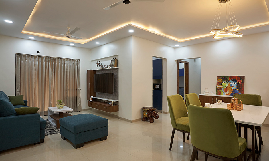 Dining area designed with hanging lights, dining table and four chairs designed by the best interior designer in Kalyan City Mumbai.
