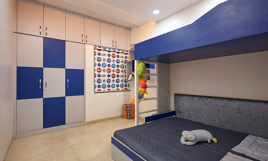 Kids bedroom designed by dc interior design company in Kalyan City Mumbai with bunk bed and wardrobe looks minimal.